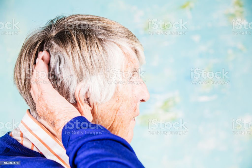 Senior woman with cochlear implant stock photo