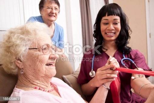 istock Senior woman with daughter and physical therapist. Resistance band. Therapy. 155420977