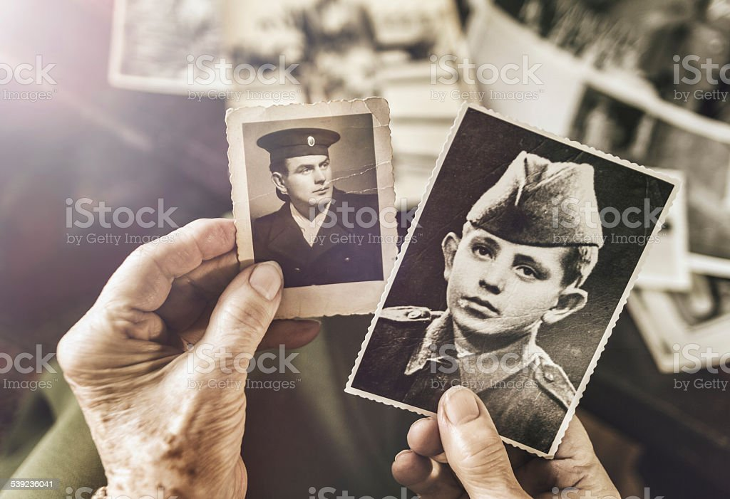 Senior woman with dear photographs of her husband stock photo