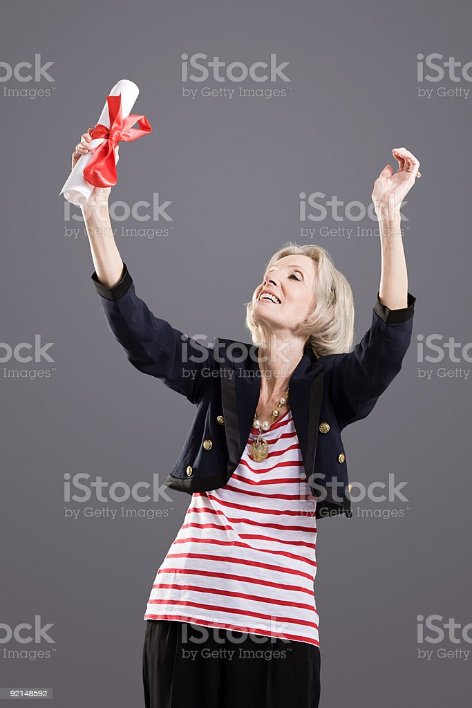 Senior woman with diploma royalty-free stock photo