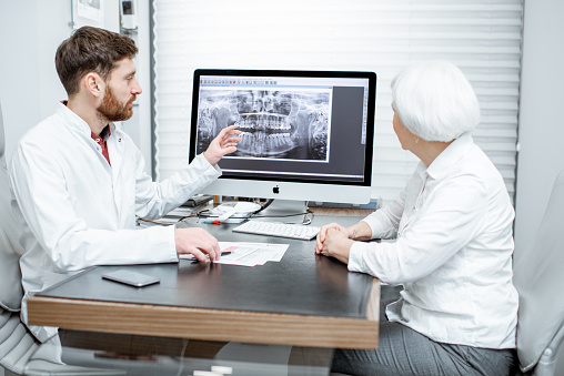 istock Senior woman with doctor in the office 1089615980