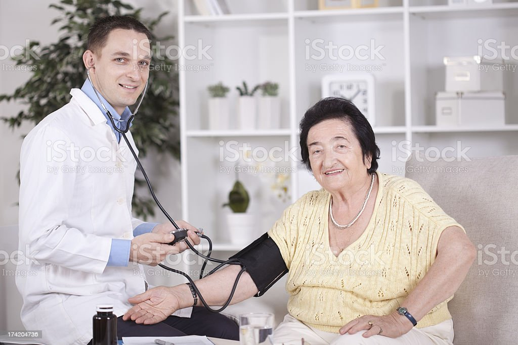 Senior woman with doctor. royalty-free stock photo