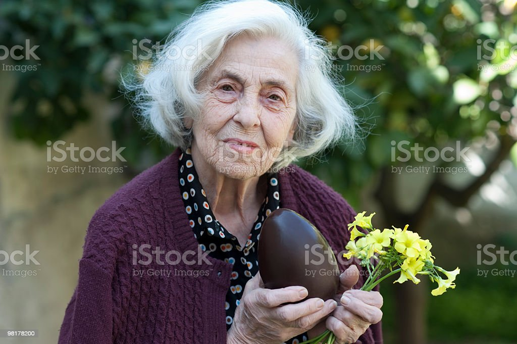 Senior woman with easter chocolate egg royalty-free stock photo