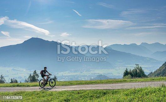 istock senior woman with electric mountain bike 1164732973
