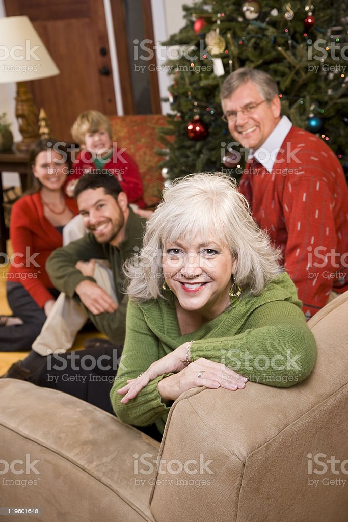 Senior woman with family by Christmas tree royalty-free stock photo