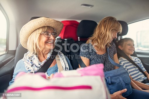Senior woman aged 70 and her family are having fun during road trip.  Nikon D850