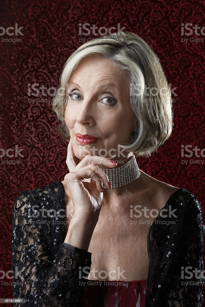 Senior Woman With Finger On Chin royalty-free stock photo