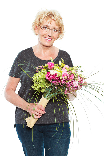 Senior Woman With Flowers On White Background Stock Photo - Download Image Now