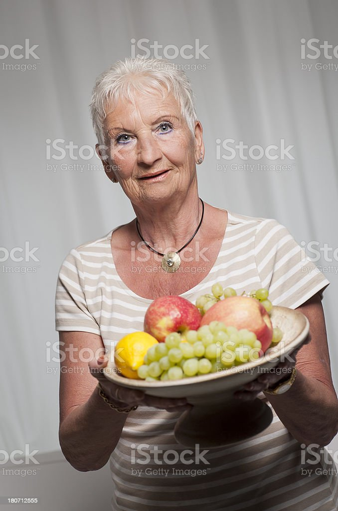 Senior woman with fruits royalty-free stock photo