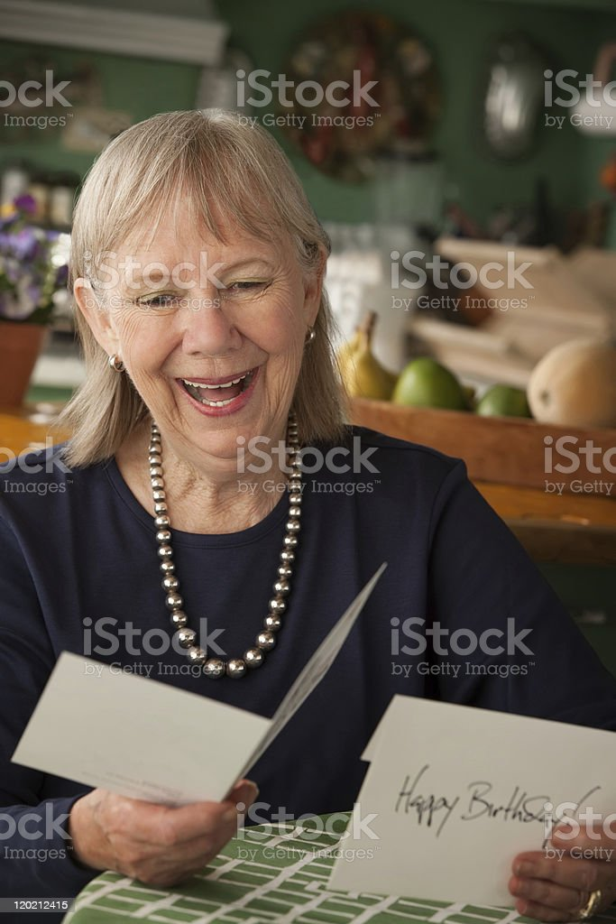 Senior woman with greeting card royalty-free stock photo