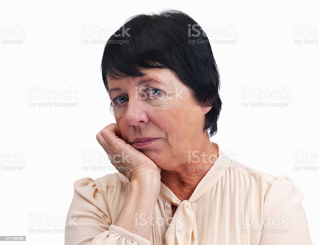 Senior woman with hands on chin against white royalty-free stock photo