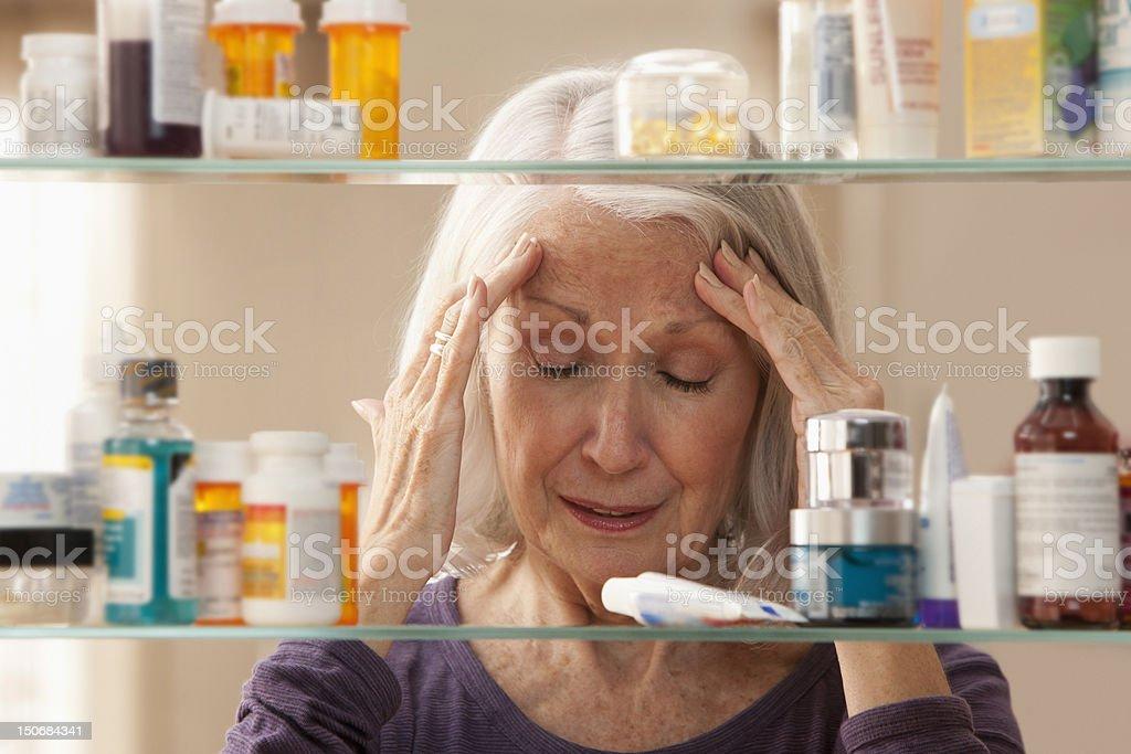 Senior woman with headache royalty-free stock photo