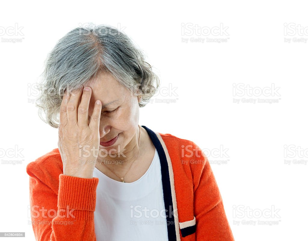 Senior woman with headache stock photo