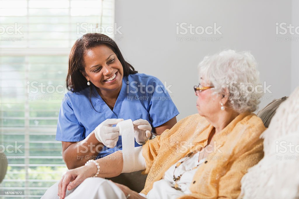 Senior woman with healthcare worker stock photo
