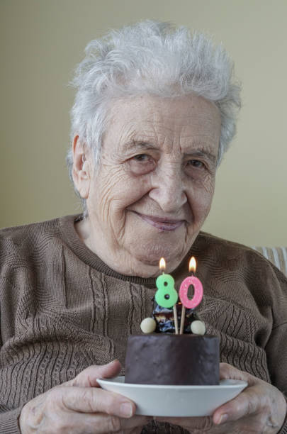 Senior Woman With Her Birthday Cake For Age Eighty Stock Photo More Pictures Of 80 89 Years