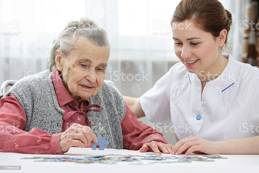 Senior woman with her caregiver royalty-free stock photo