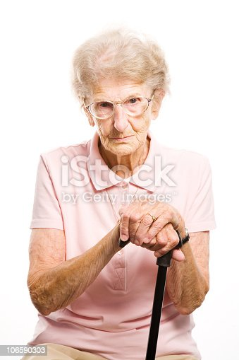 istock senior woman with her walking stick 106590303