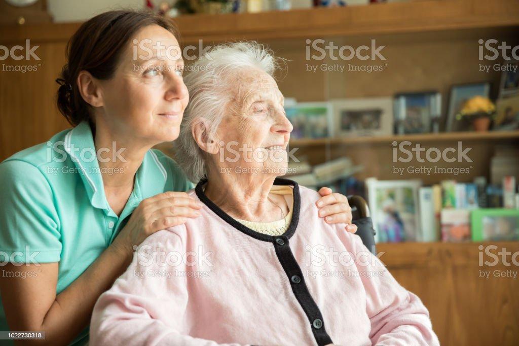 Senior woman with home caregiver