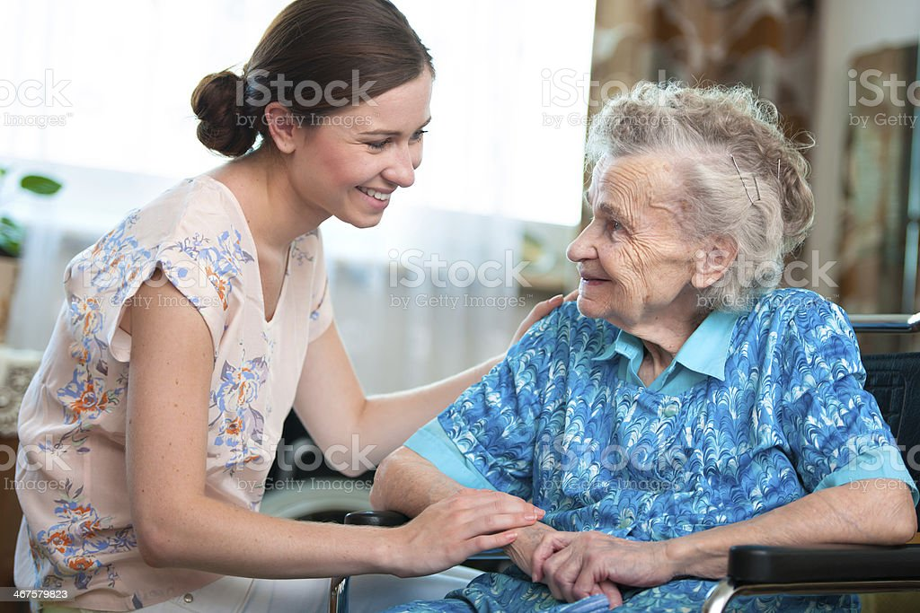 senior woman with home caregiver - Royalty-free 80-89 Years Stock Photo
