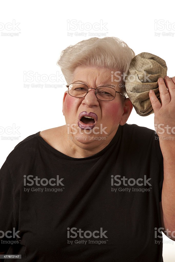 Senior woman with ice pack royalty-free stock photo