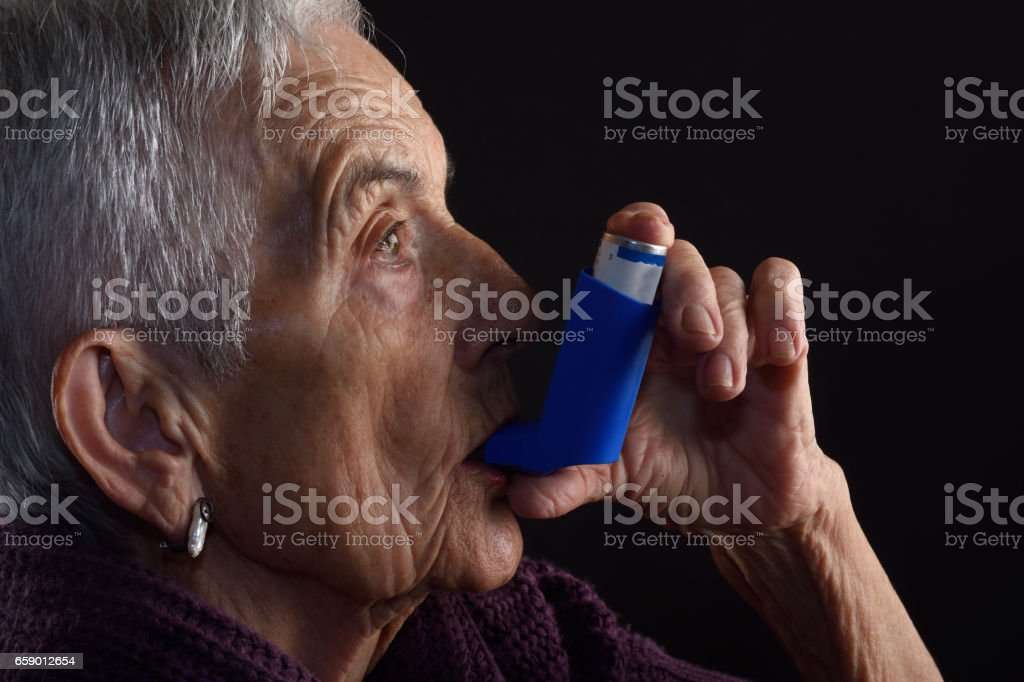 Senior woman with inhaler royalty-free stock photo
