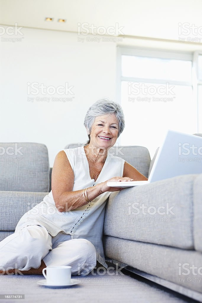 Senior woman with laptop and coffee cup royalty-free stock photo