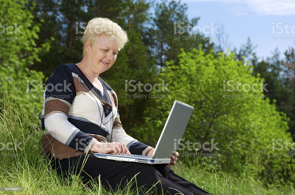 Senior woman with laptop royalty-free stock photo
