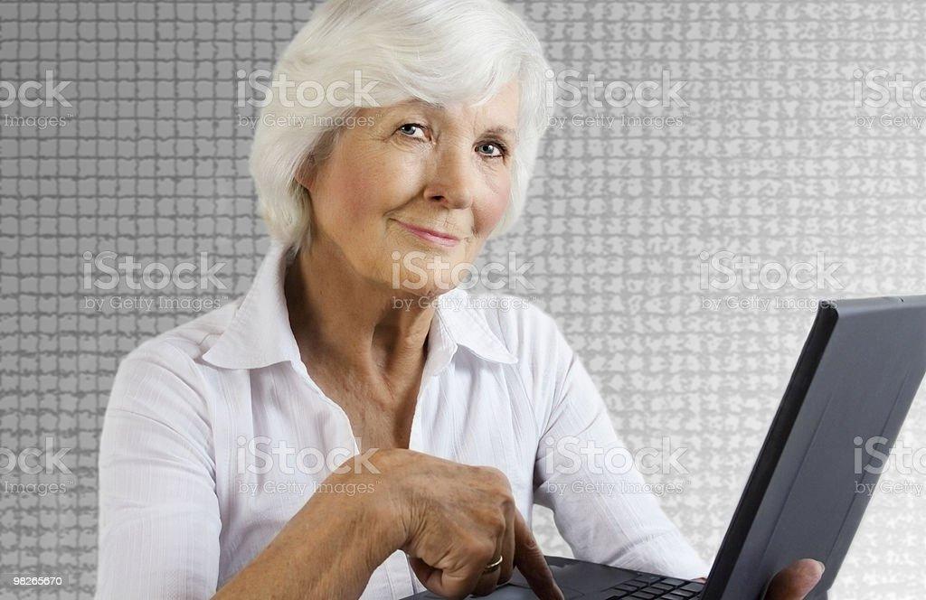 Senior woman with laptop royalty-free stock photo