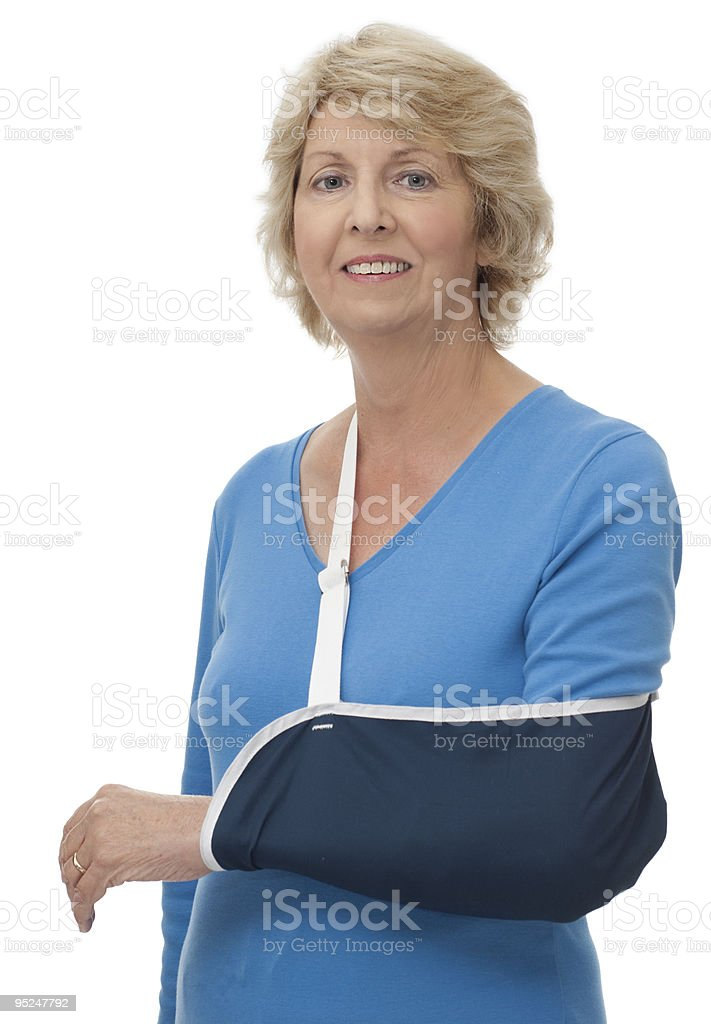 Senior woman with left arm in sling stock photo
