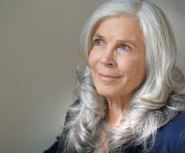 Senior woman with long silver hair stock photo