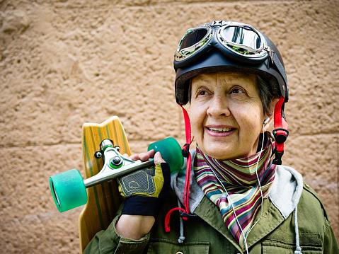 Senior woman with longboard