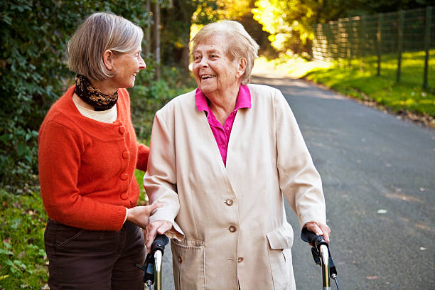 senior woman with mature daughter stock photo
