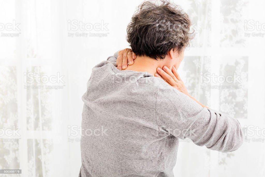 senior woman with neck pain stock photo