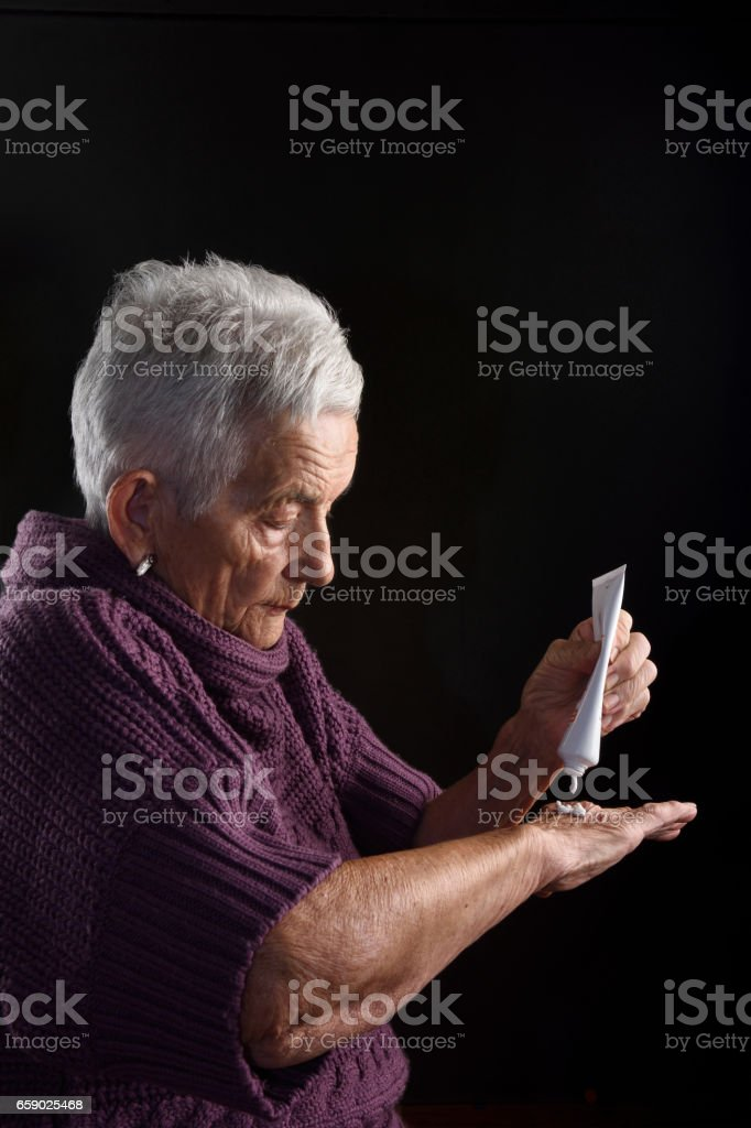 Senior woman with ointment royalty-free stock photo