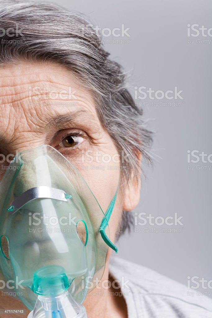 Senior woman with oxygen mask stock photo
