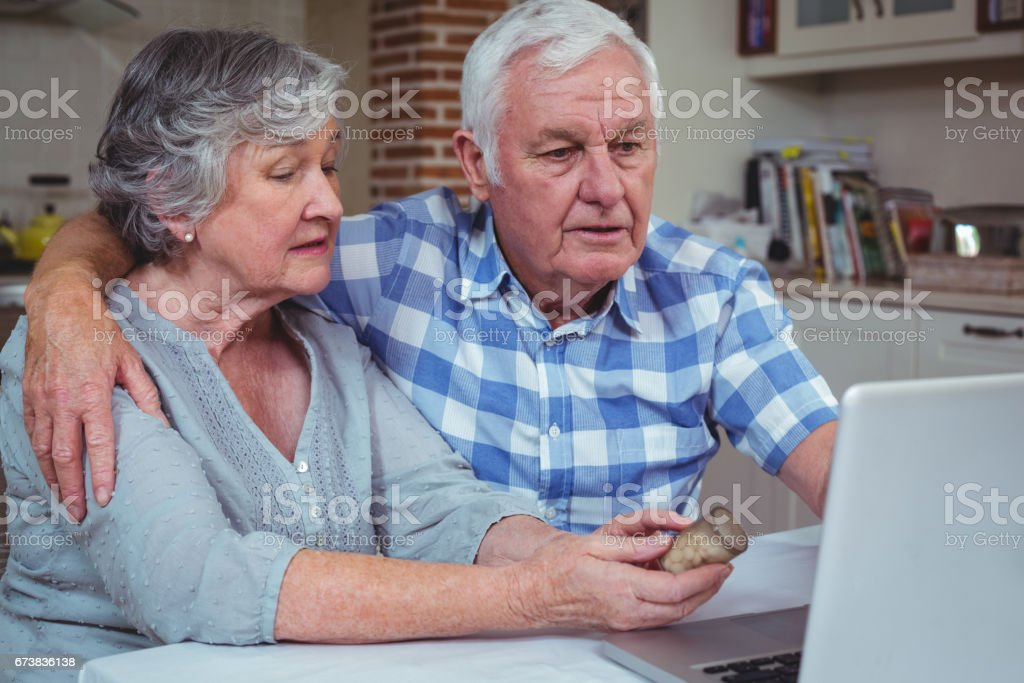 Senior woman with pills interacting with husband stock photo
