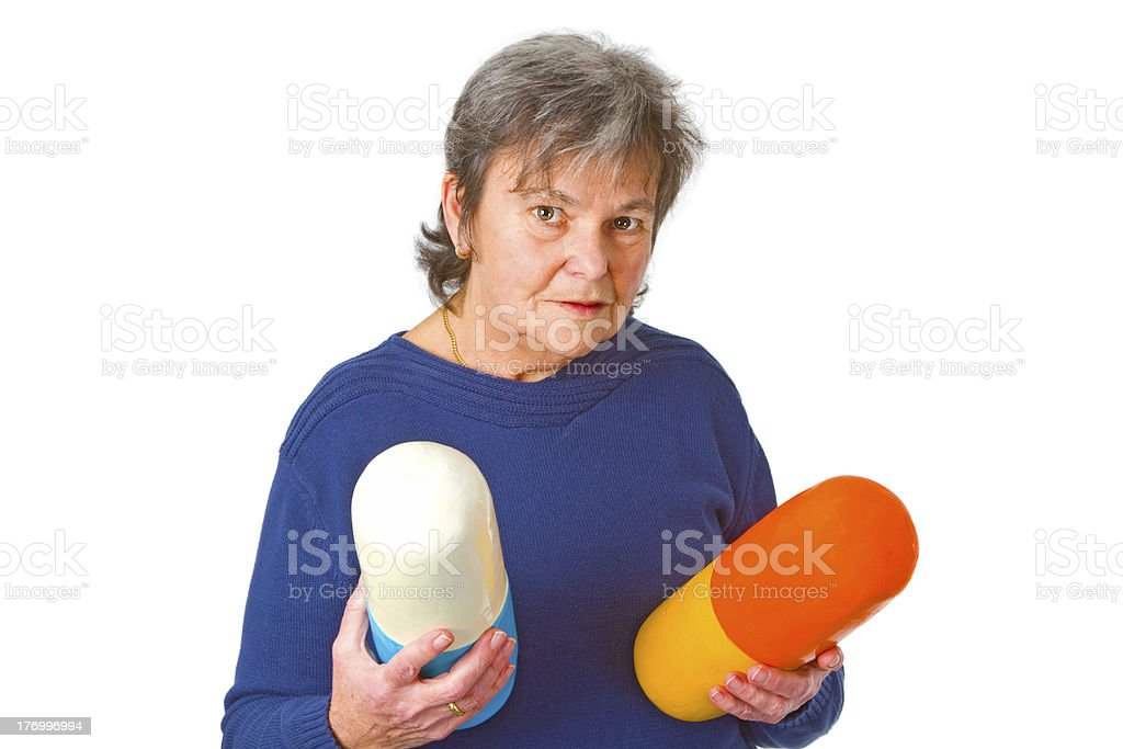 Senior woman with pills stock photo