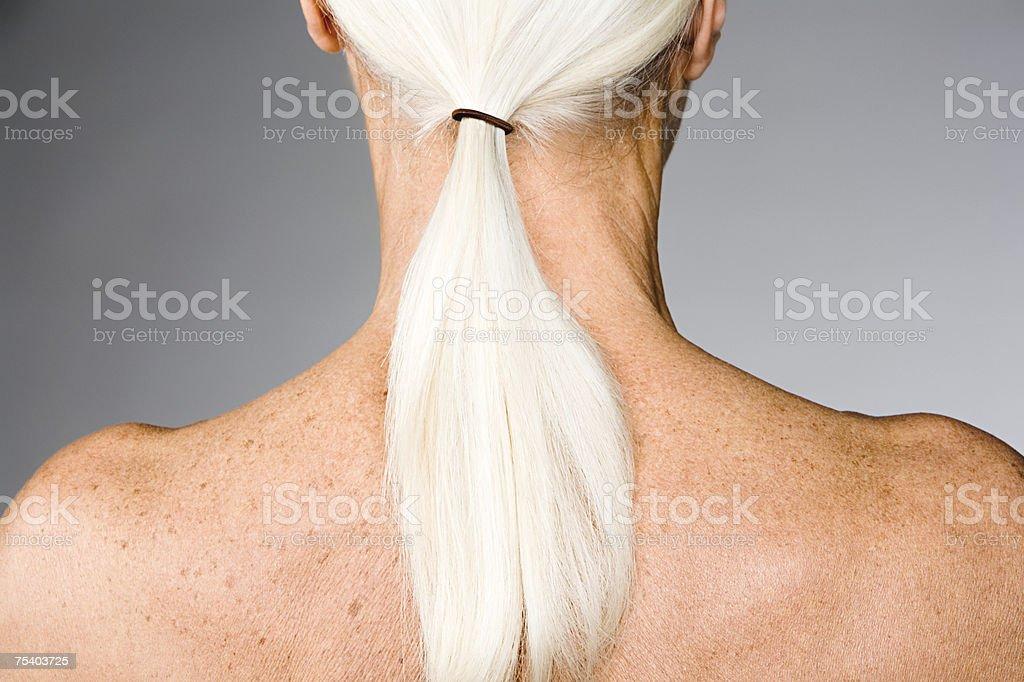 Senior woman with ponytail stock photo
