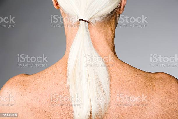 Senior Woman With Ponytail Stock Photo - Download Image Now