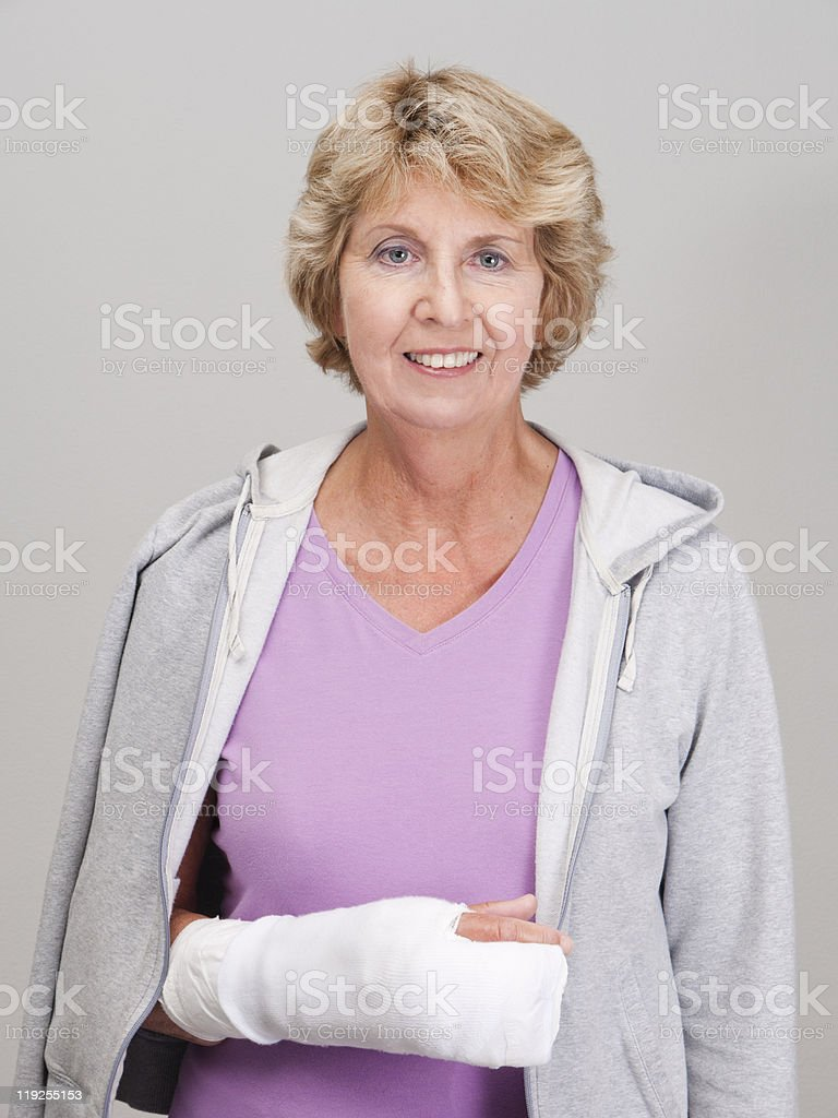 Senior woman with right arm and hand in bandages royalty-free stock photo