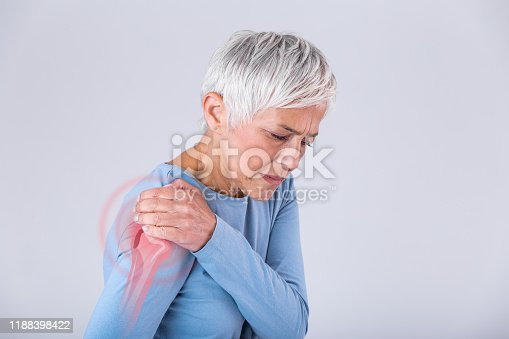 istock Senior woman with shoulder pain. Elderly woman is enduring awful ache. Shoulder Pain In An Elderly Person. Senior lady with shoulder pain 1188398422