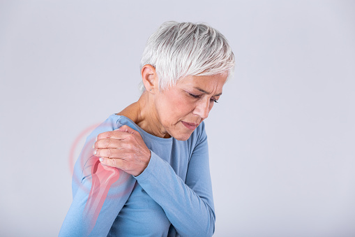 Senior woman with shoulder pain. Elderly woman is enduring awful ache. Shoulder Pain In An Elderly Person. Senior lady with shoulder pain