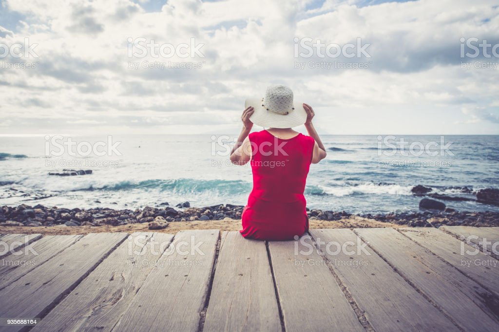 Senior woman with sun hat stock photo