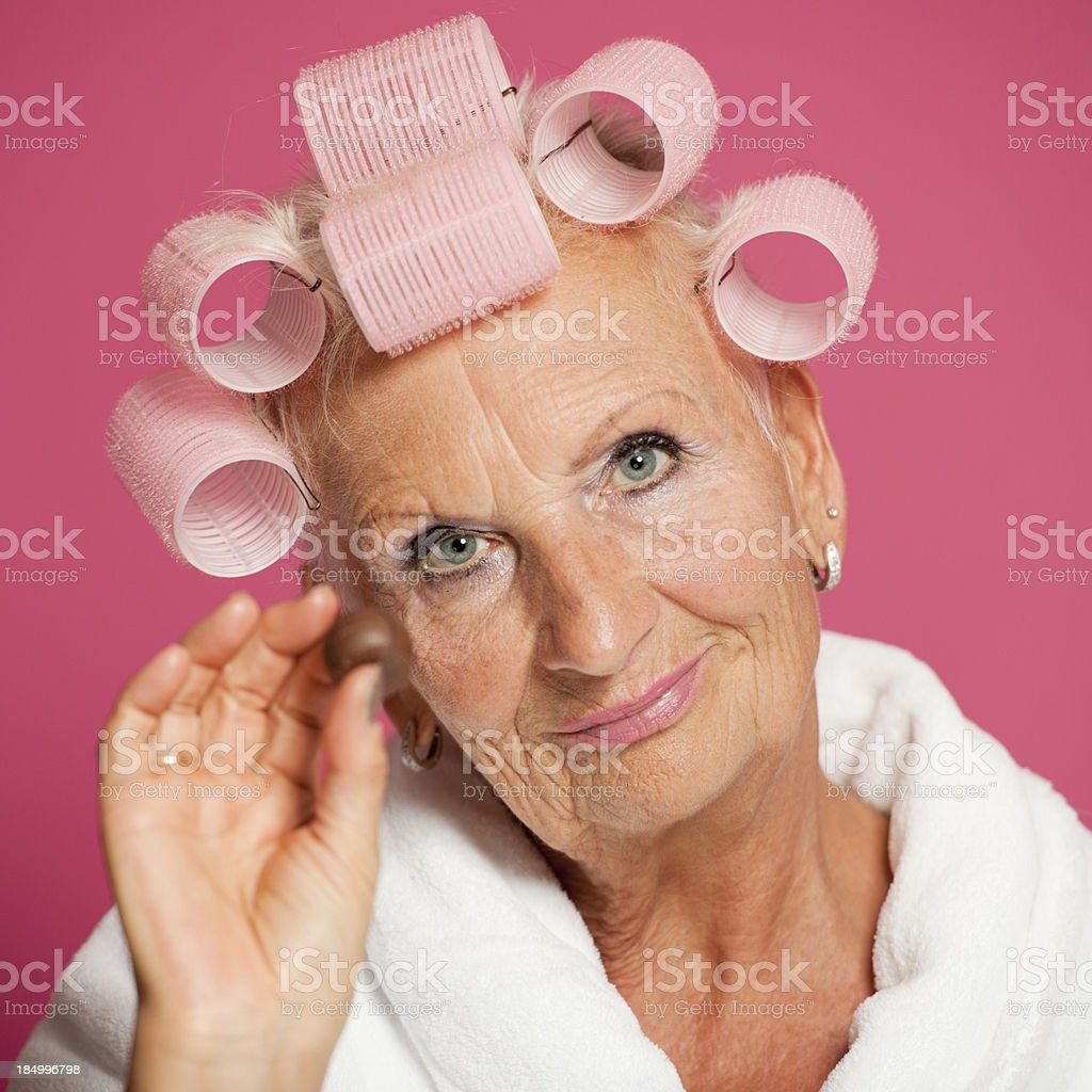 Senior woman with sweeties royalty-free stock photo