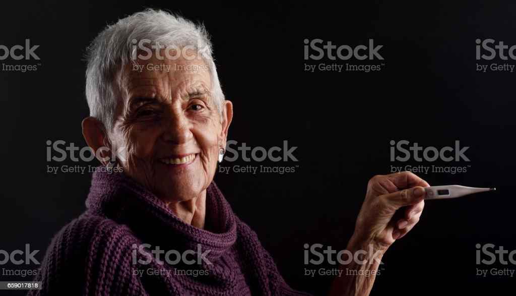 Senior woman with thermometer royalty-free stock photo