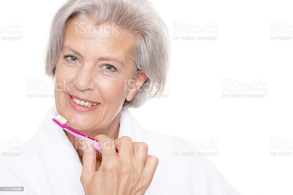Senior woman with toothbrush royalty-free stock photo