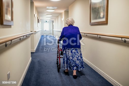 istock Senior Woman with Walker in a Care Home 938467396