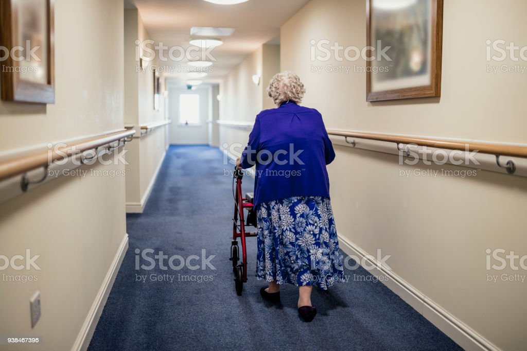 Senior Woman with Walker in a Care Home stock photo