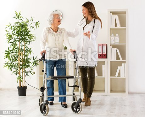 istock Senior woman with walker on consultation with the doctor 638124540