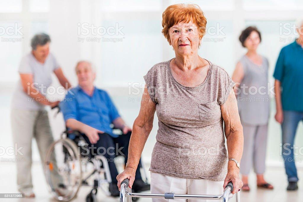 Senior woman with walker. stock photo